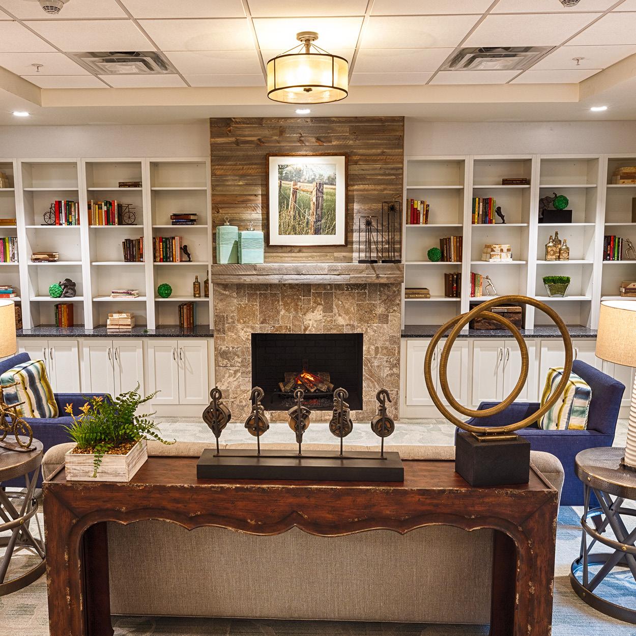 Sitting room at Stonerise Charleston with fireplace and bookshelves