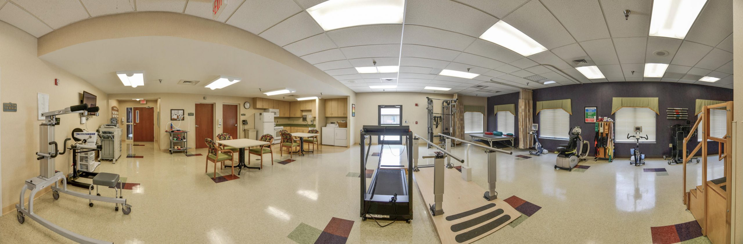 Panoramic view of Stonerise Clarksburg Physical Therapy and Rehabilitation room with exercise equipment