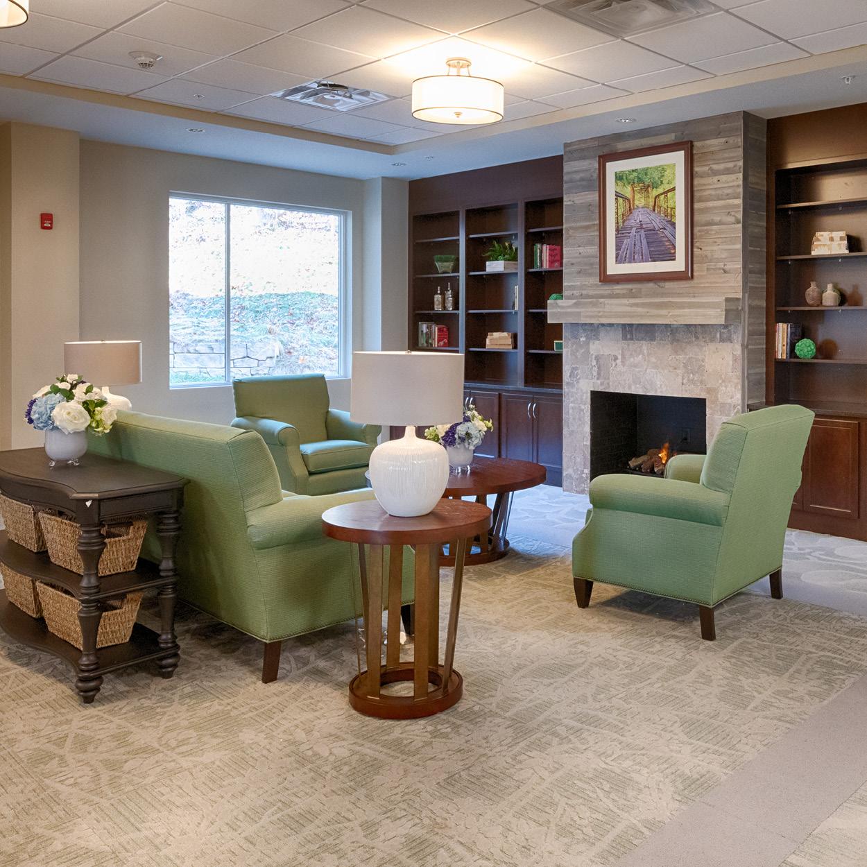 Stonerise Charleston sitting room with fireplace and bookshelves