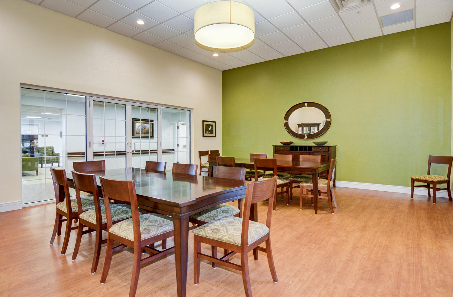 Stonerise Morgantown gathering room with two tables and large glass doors