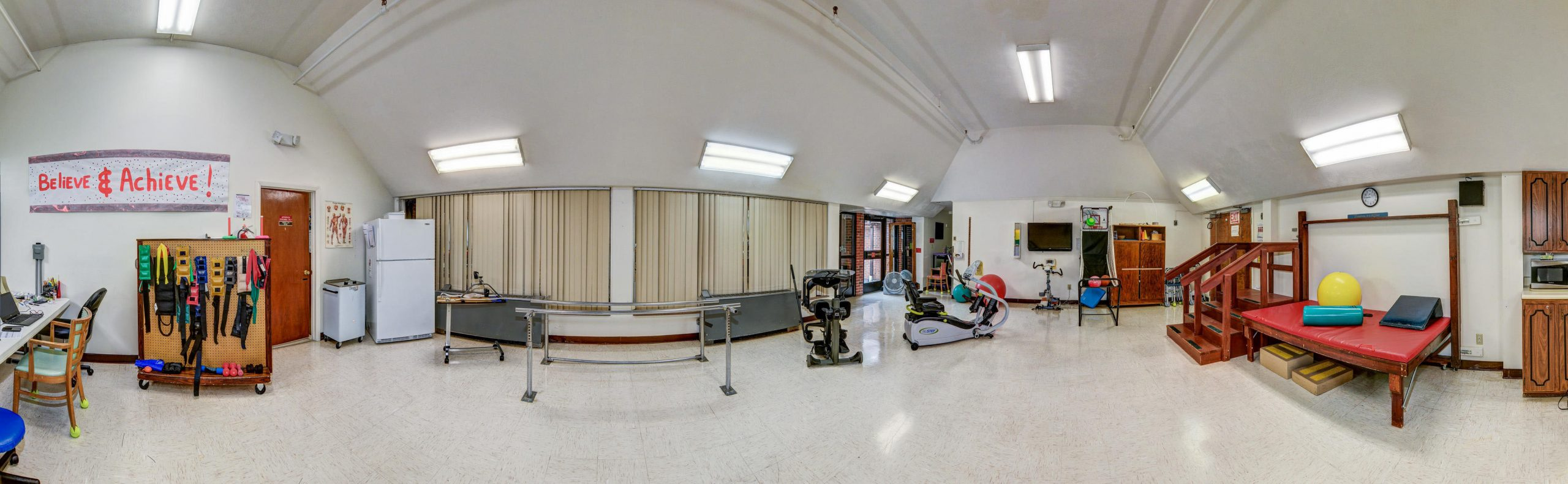 Panoramic view of Stonerise Princeton Therapy and Rehabilitation room with equipment