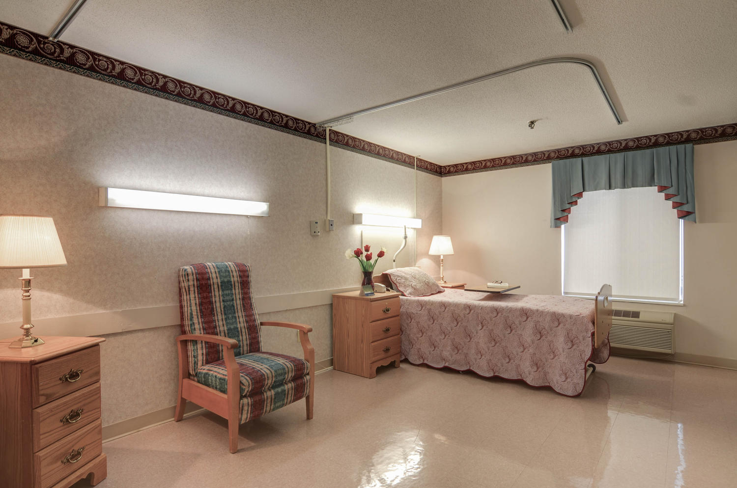 Stonerise Beckley private patient room with bed, chair and flowers
