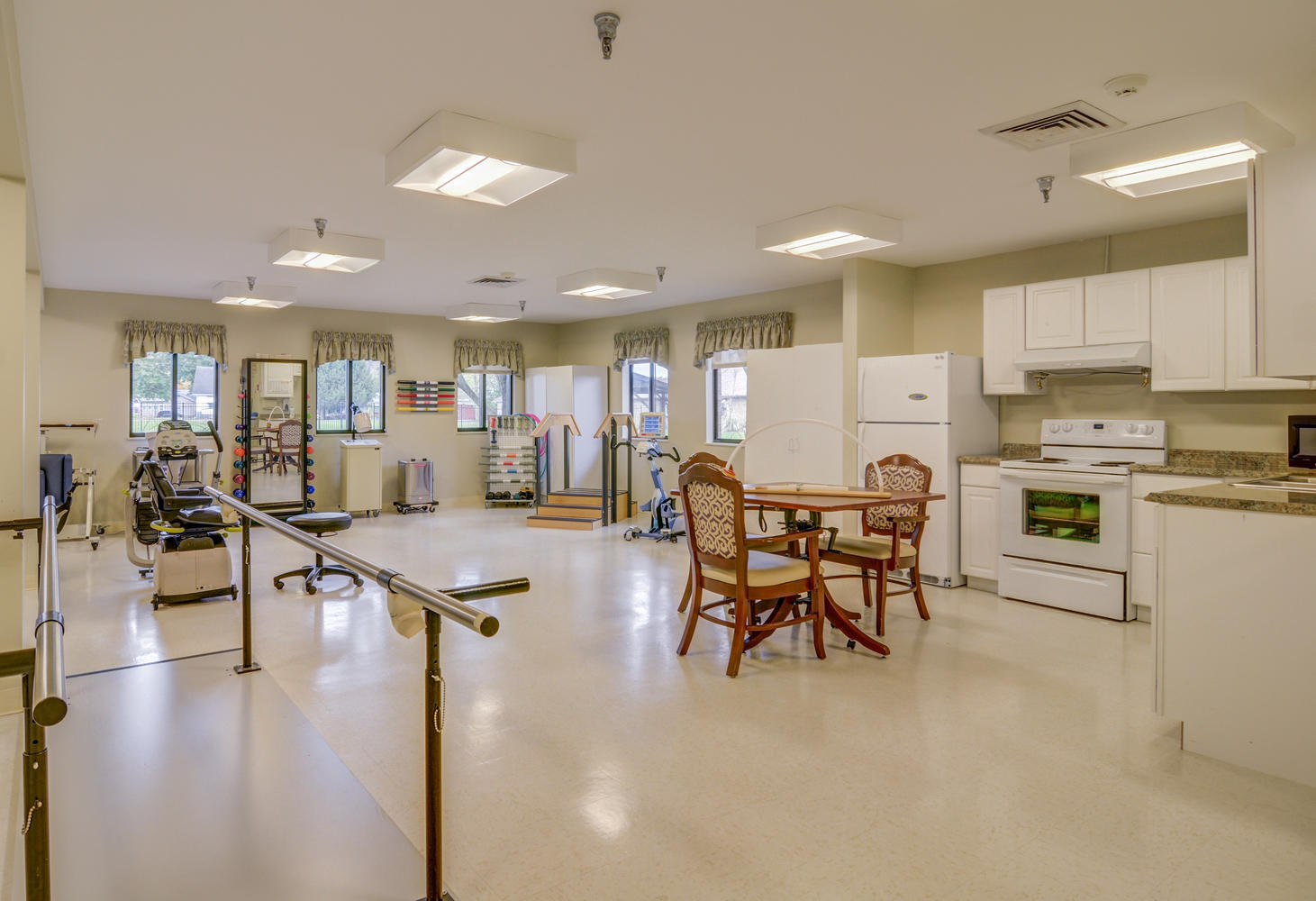 Stonerise Belmont Therapy and Rehabilitation room with equipment and kitchen area