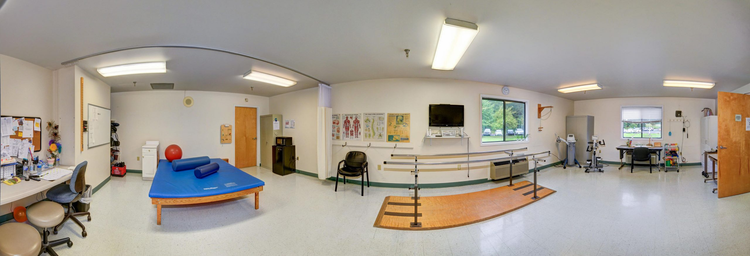 Panoramic view of Stonerise Berkeley Springs Therapy and Rehabilitation area with equipment and desk