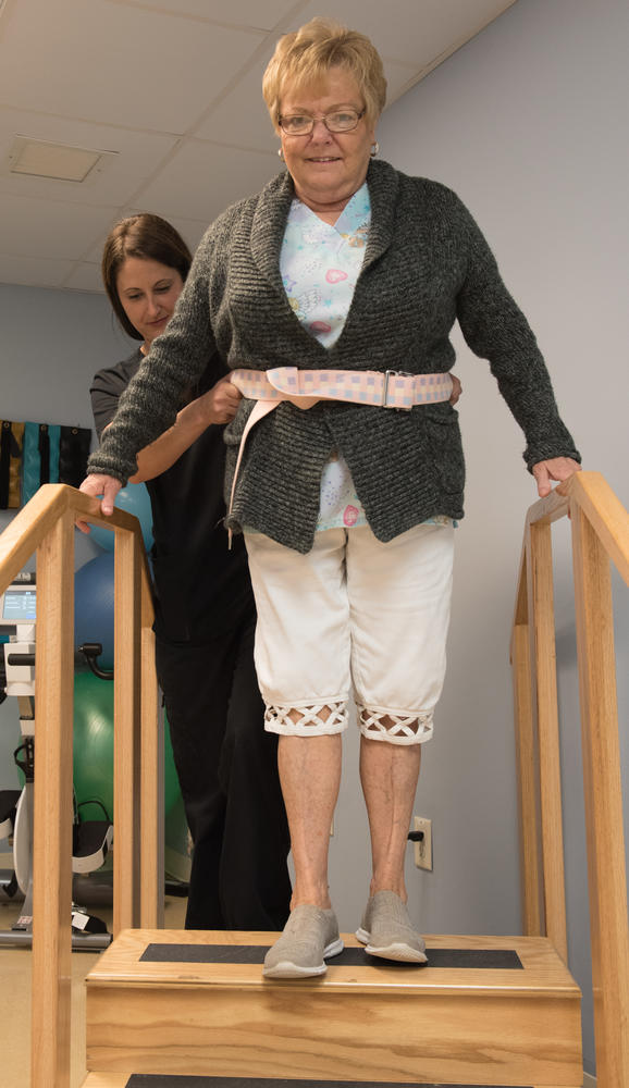 Stonerise Wellsburg Physical Therapy session with patient climbing stairs