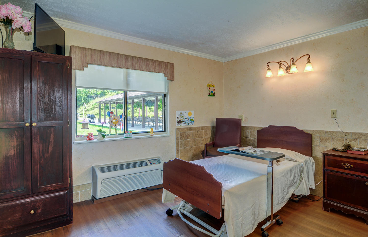 Stonerise Bridgeport patient room with children's art, small gifts and TV