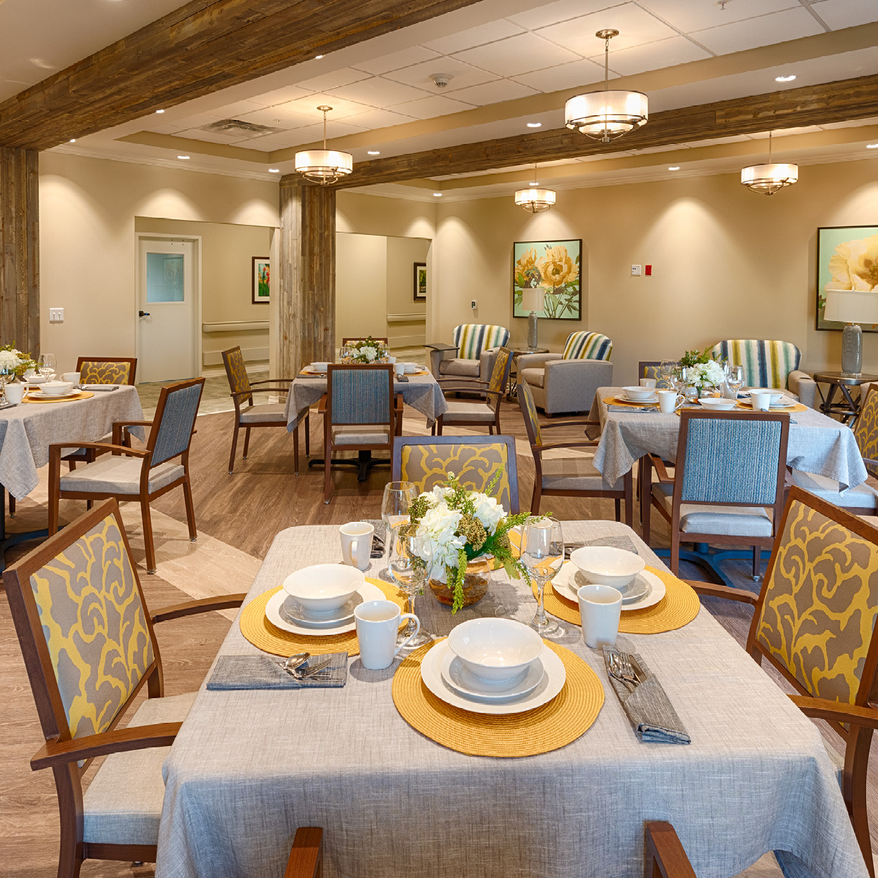 Stonerise Charleston dining room tables with place settings and floral centerpieces