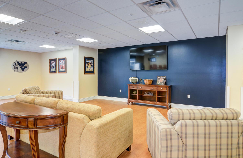Stonerise Morgantown West Virginia room with TV and sports memorabilia