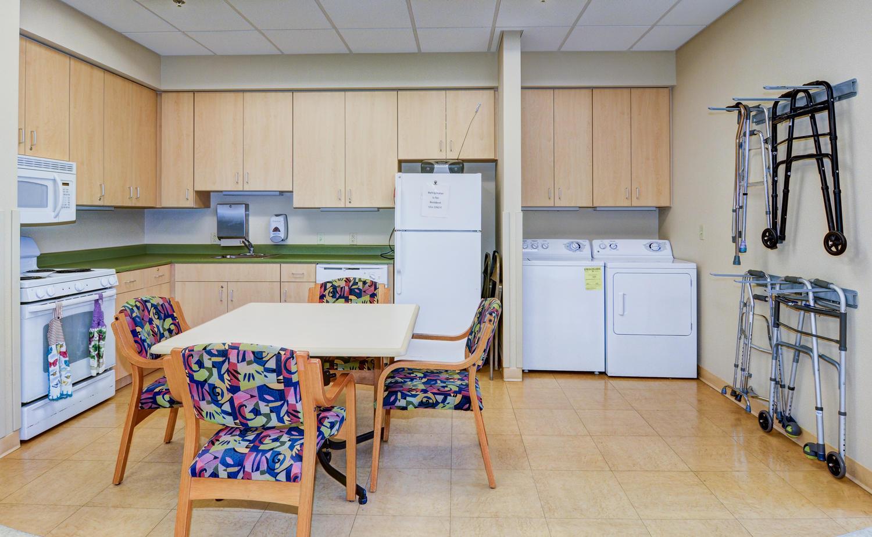 Kitchen and laundry area in Stonerise Keyser Rehabilitation room