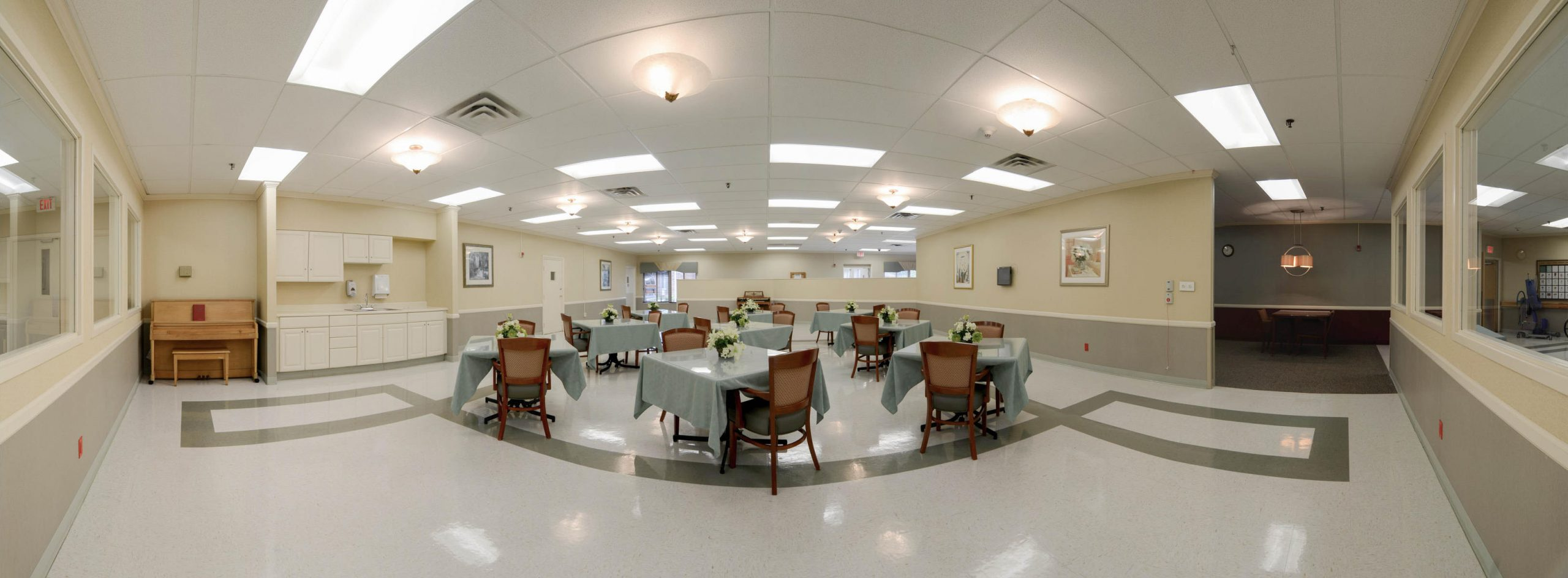 Panoramic view of Stonerise Beckley dining room with tables and piano