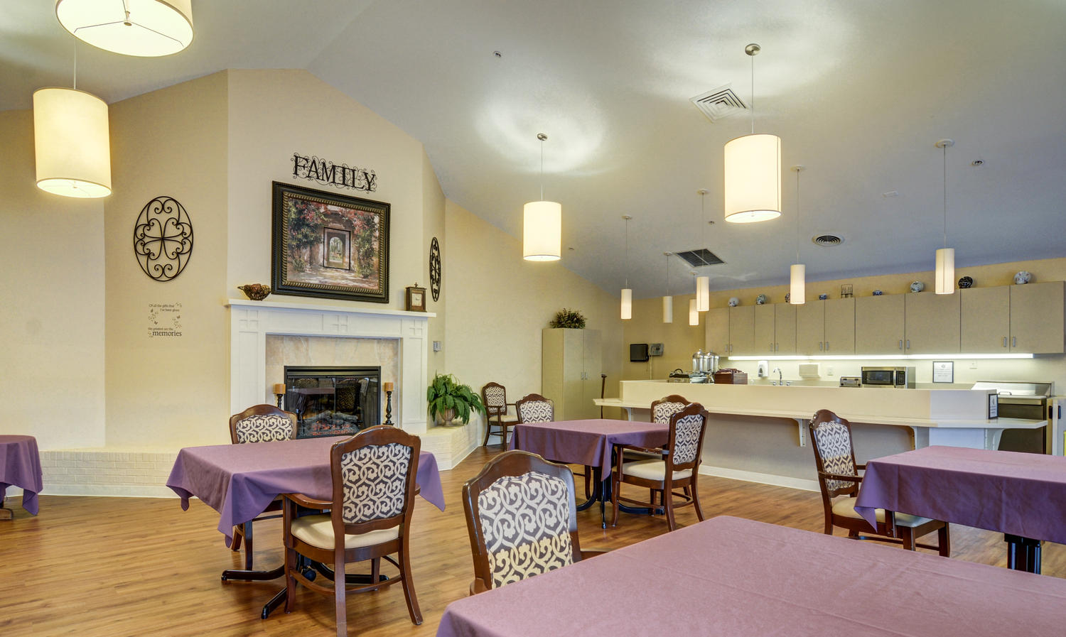 Stonerise Belmont dining room and kitchen area with fireplace