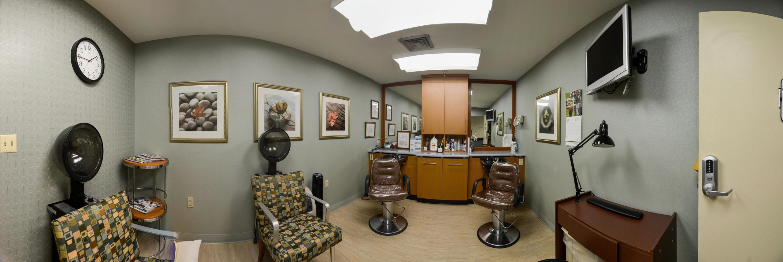 Panoramic view of Stonerise Clarksburg beauty salon with stylist chairs, hair dryers and TV