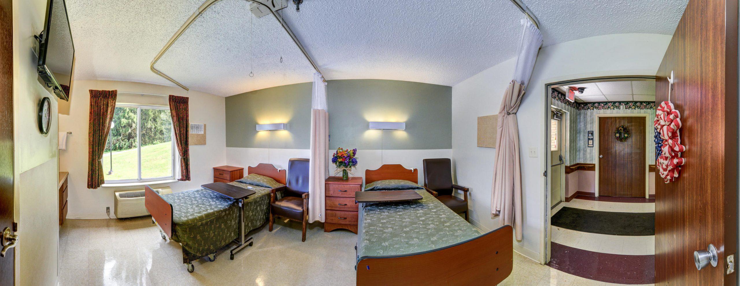 Panoramic view of Stonerise Wellsburg patient room open to hallway