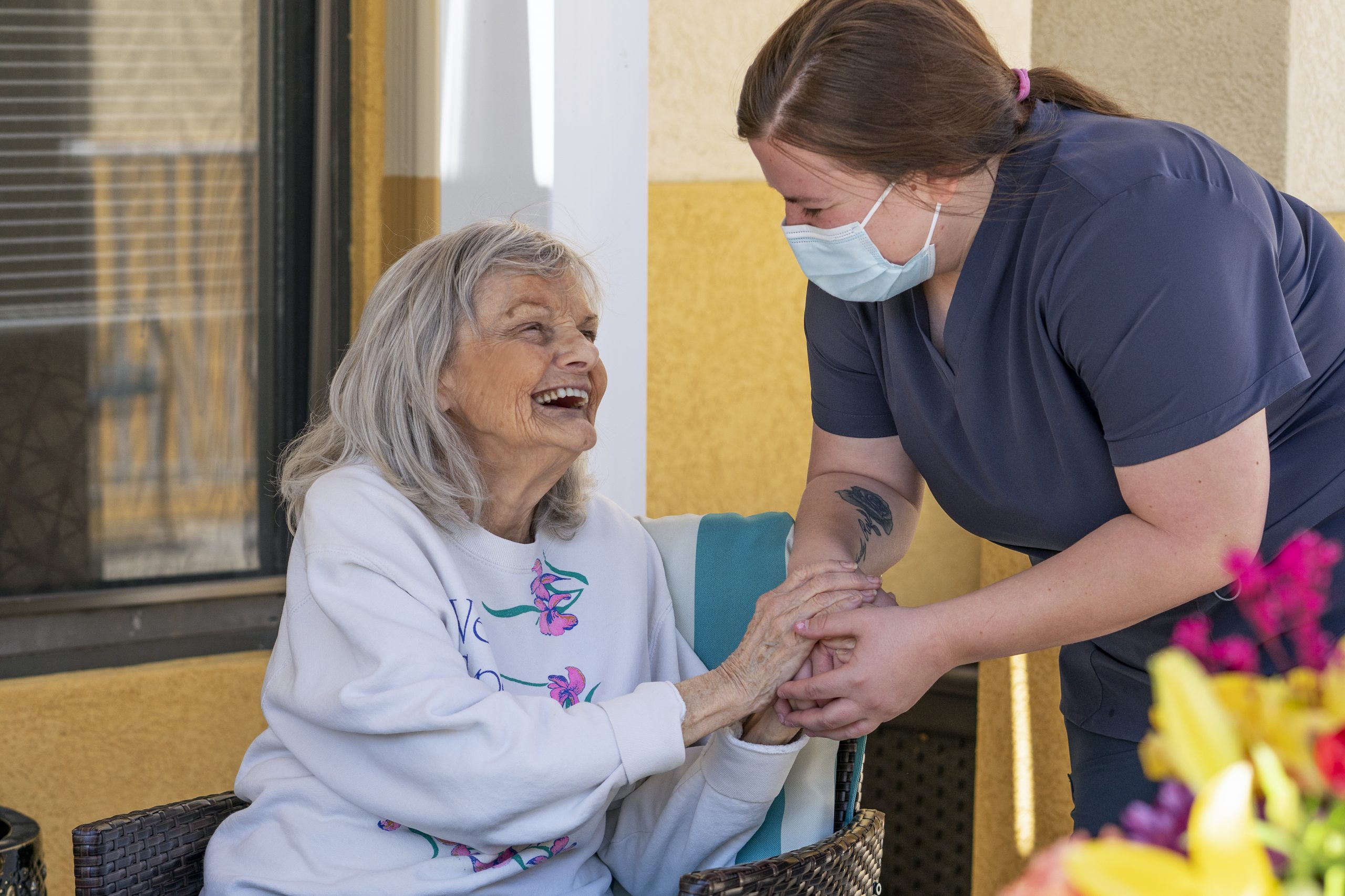 Stonerise Parkersburg patient and team member smiling in outdoor area