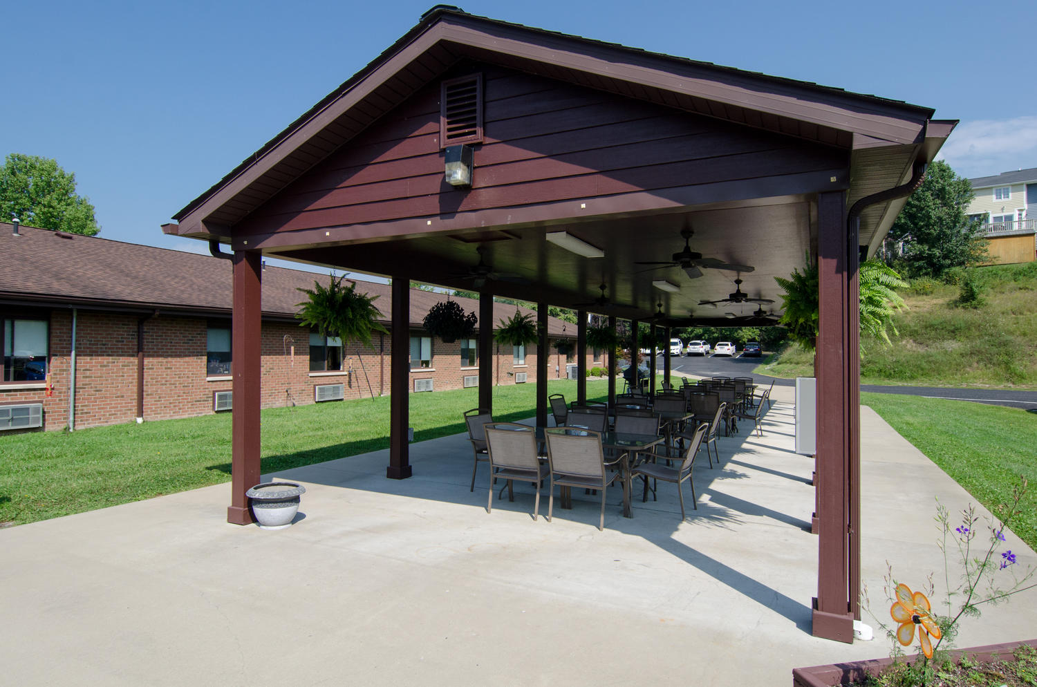 Outdoor pavilion at Stonerise Bridgeport with tables and hanging plants