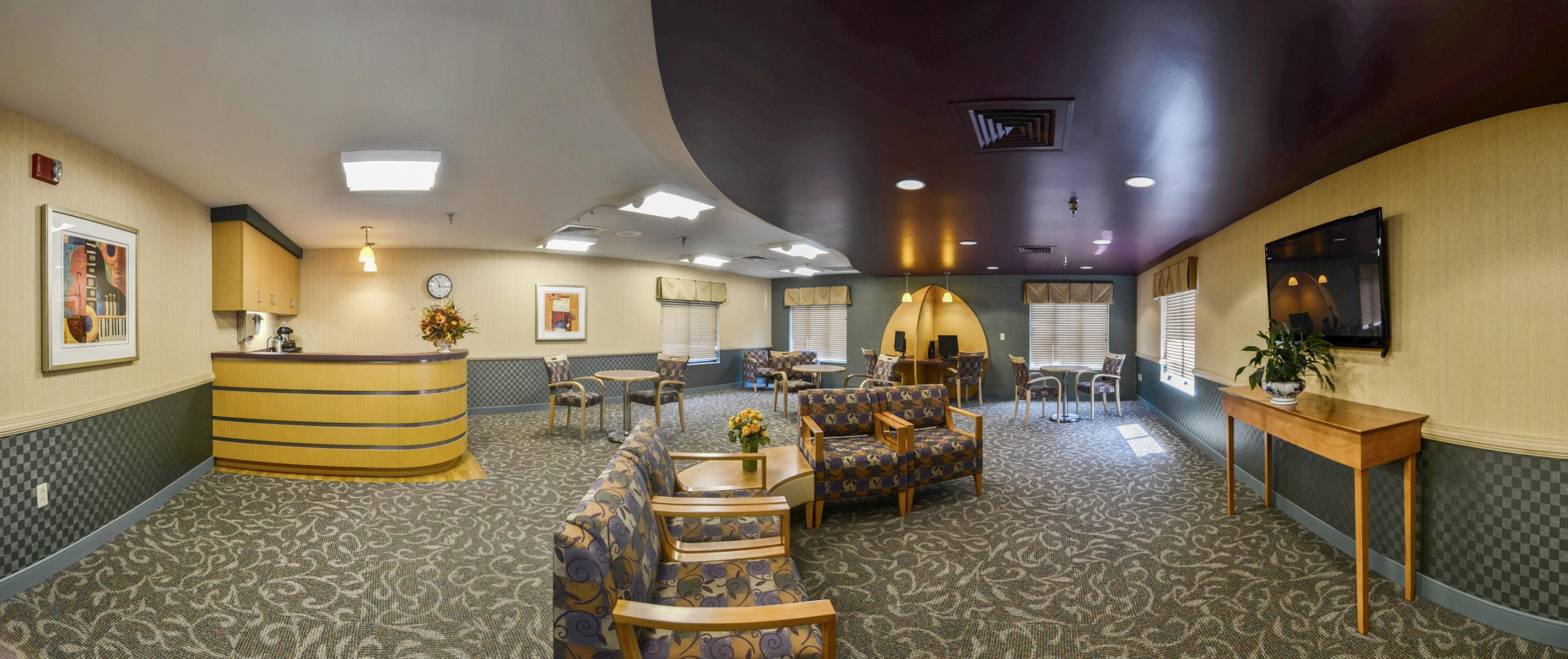 Panoramic view of Stonerise Clarksburg internet cafe with computer desks, TV area and kitchenette