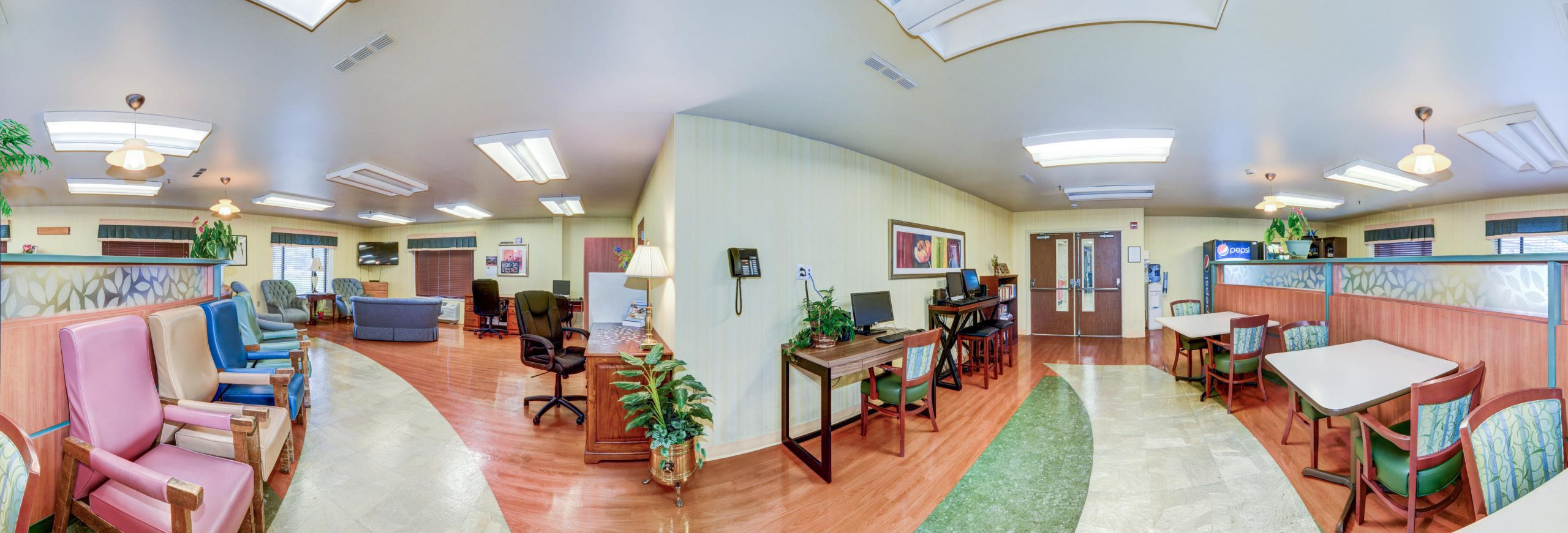 Panoramic view of Stonerise Keyser sitting room and internet cafe with TV and computer desks