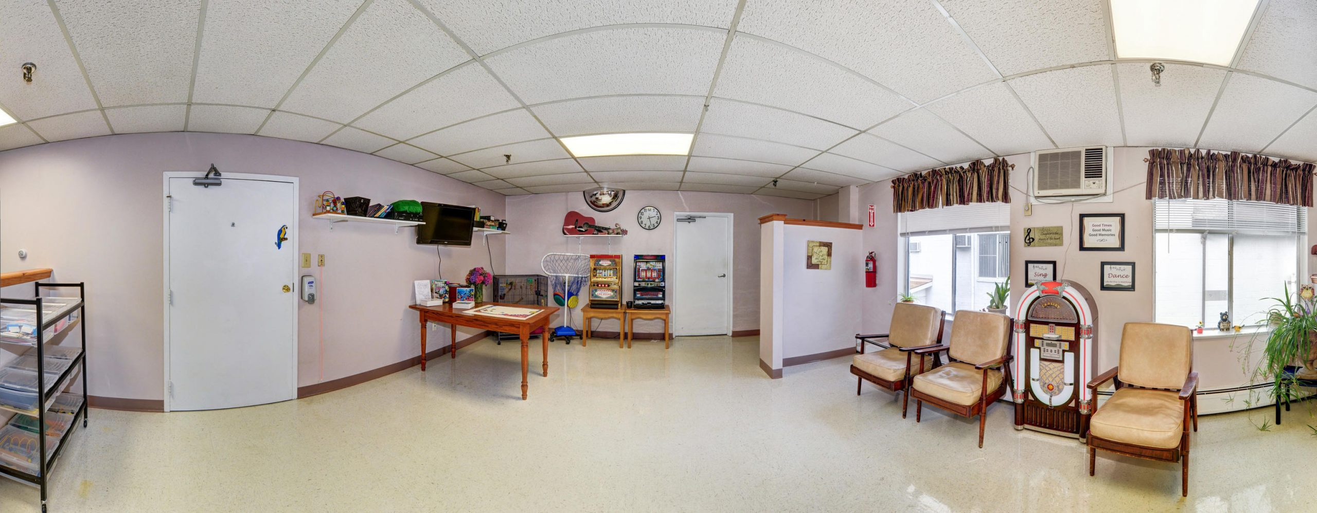 Panoramic view of Stonerise Berkeley Springs activity room with games and jukebox