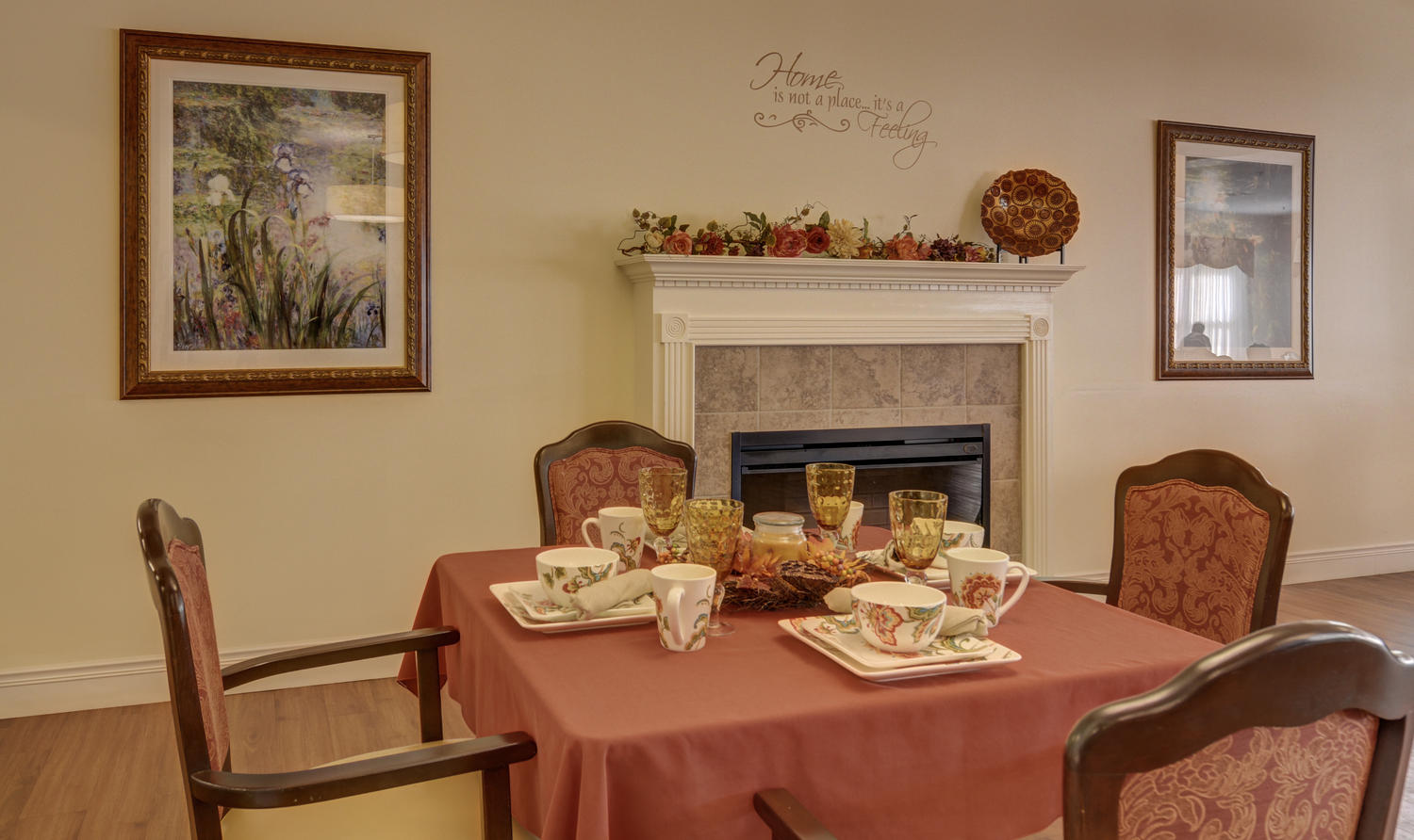 Close-up view of set table in Stonerise Lindside dining room near fireplace