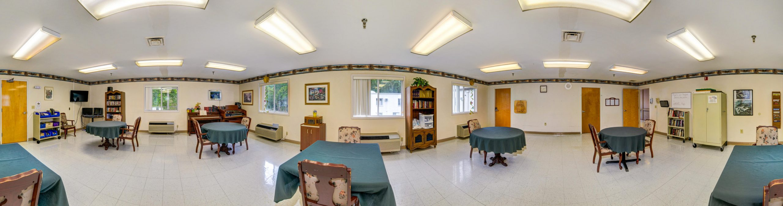 Panoramic view of Stonerise Berkeley Springs library and internet cafe with tables and bookshelves