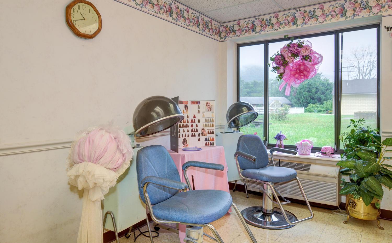 Stonerise Keyser beauty salon with stylist chairs and hair dryers