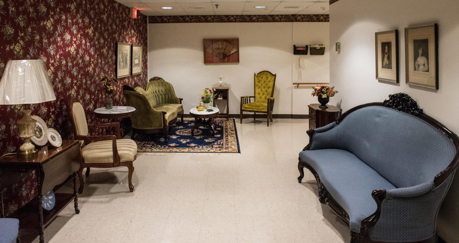 Stonerise Princeton sitting room with antique furniture and art