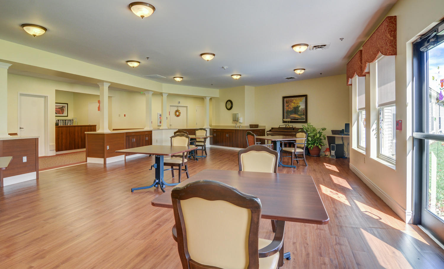 Stonerise Lindside activities room with tables and piano