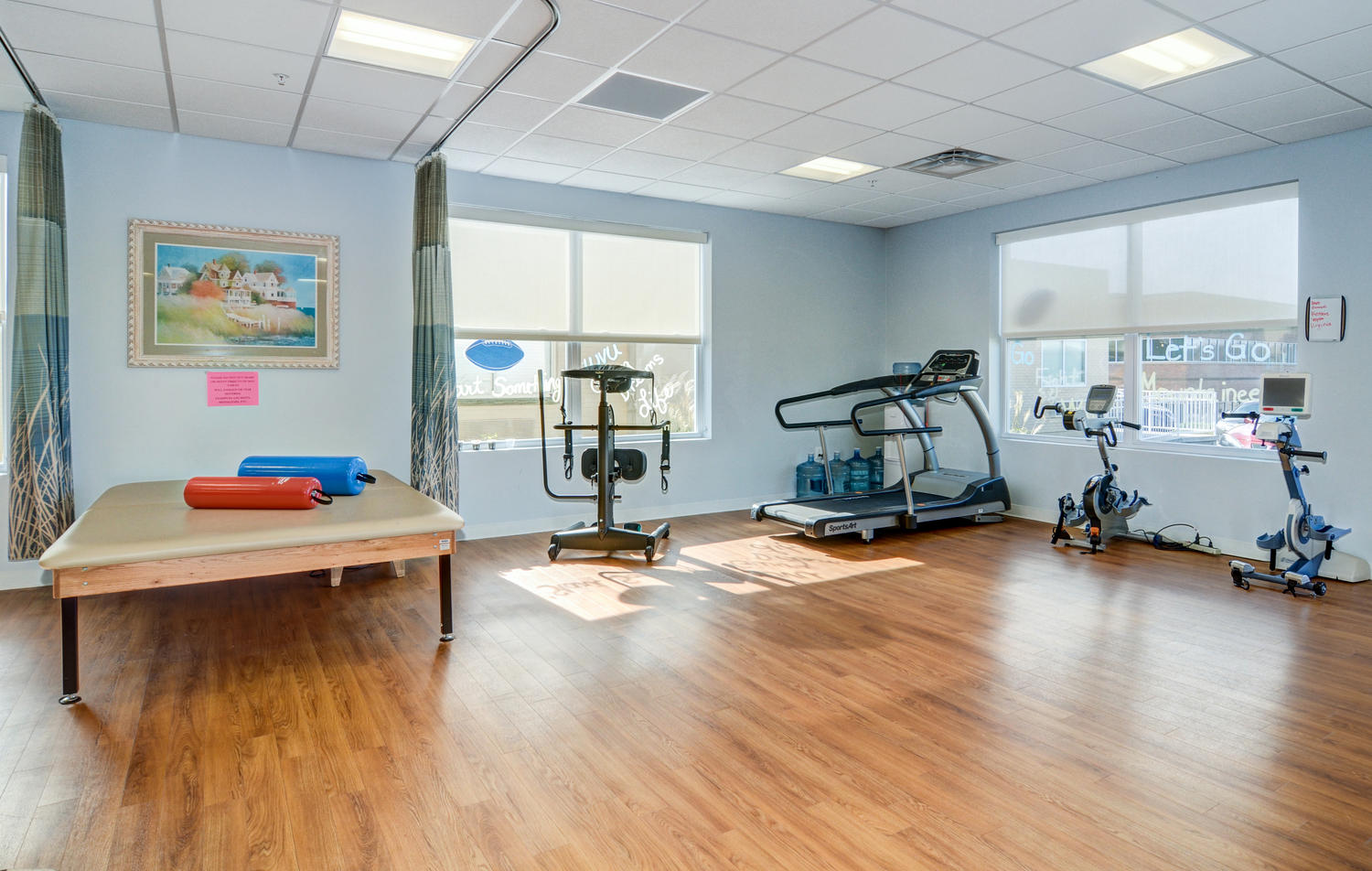 Stonerise Morgantown Therapy and Rehabilitation room with exercise equipment and sun shining through windows