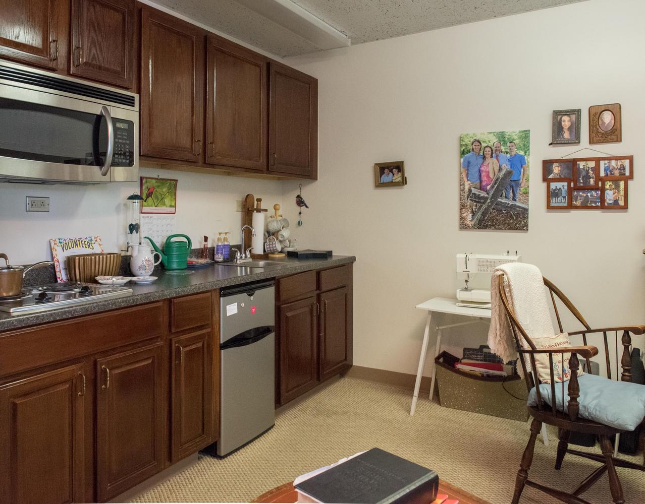 Kitchen area in Stonerise Princeton studio unit with family photos