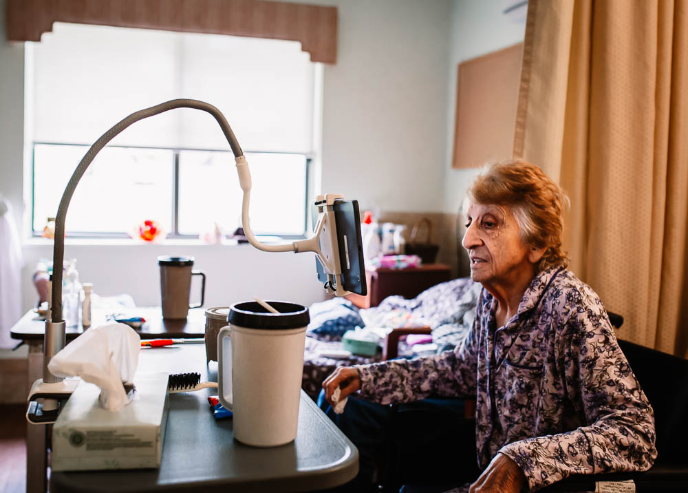 Elderly patient does virtual televisit in Stonerise skilled nursing home and transitional care facility