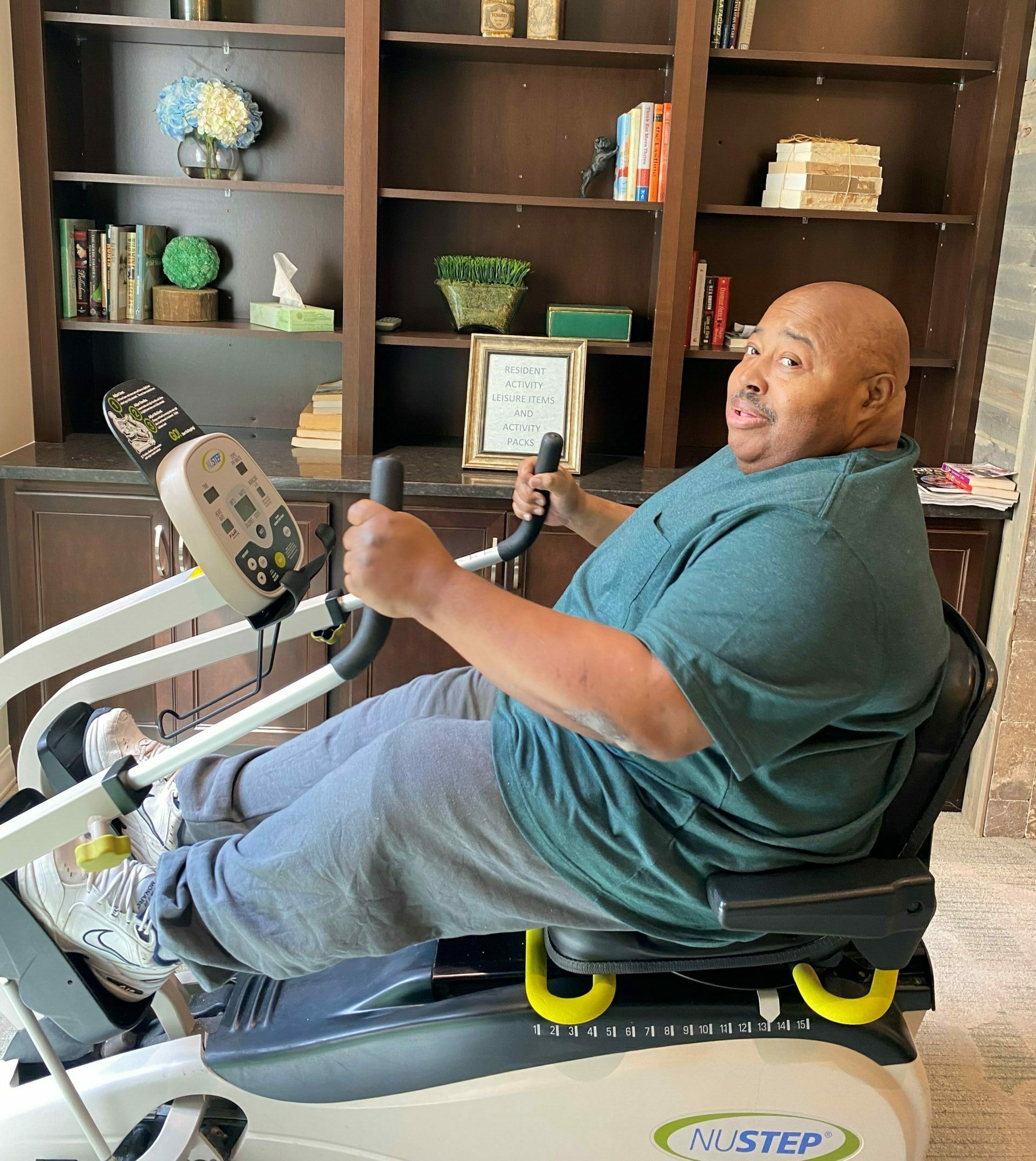 Middle-aged male therapy patient on exercise bike