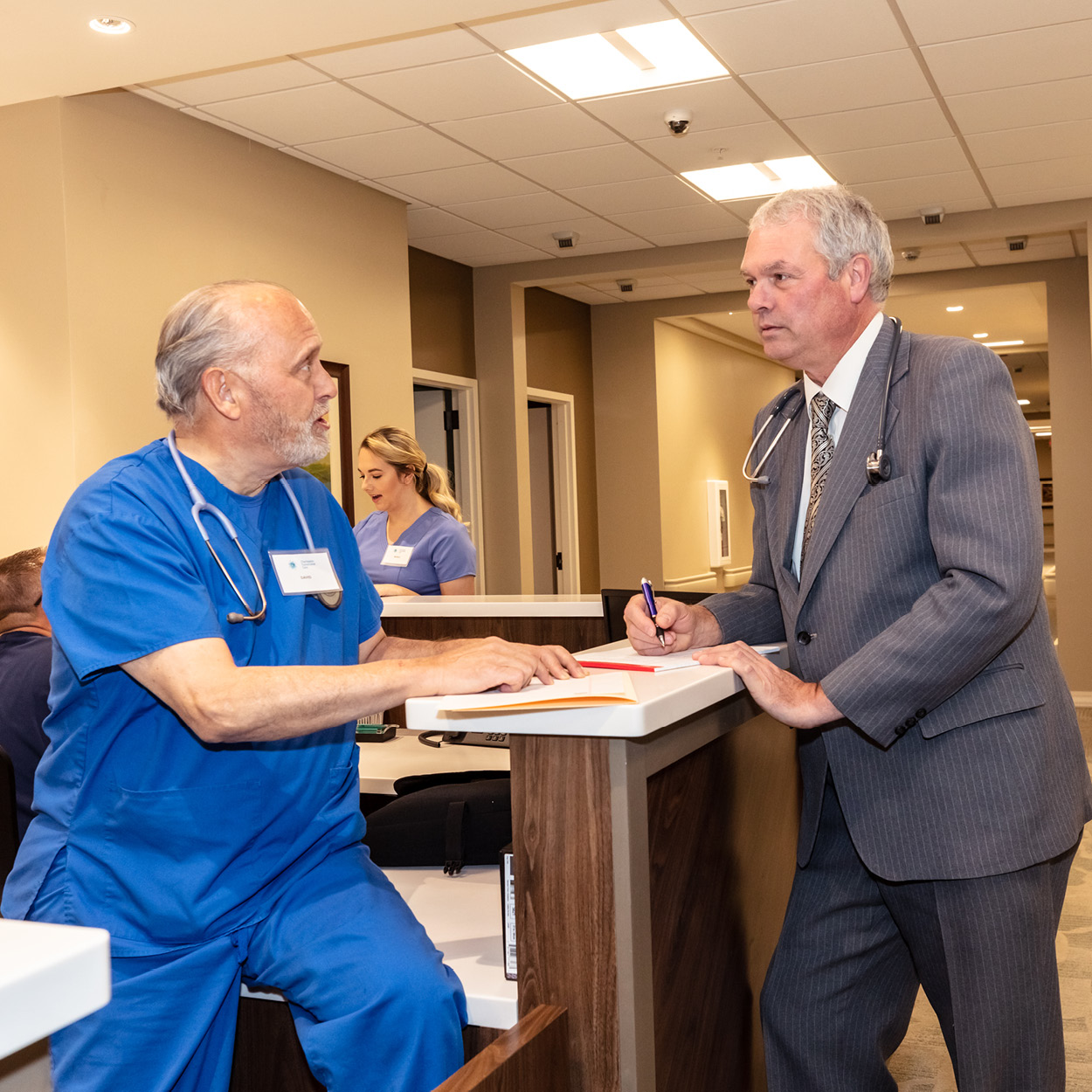 Physician talking to colleague in Stonerise Charleston skilled nursing and transitional care facility