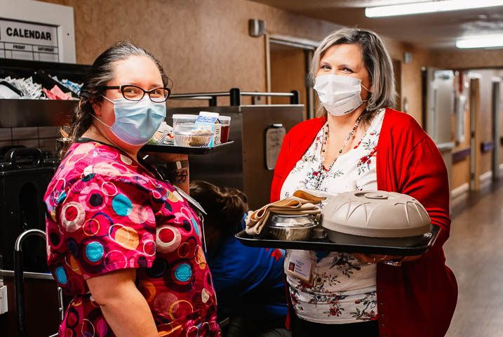 Stonerise dieticians with masks serving food in skilled nursing home facility